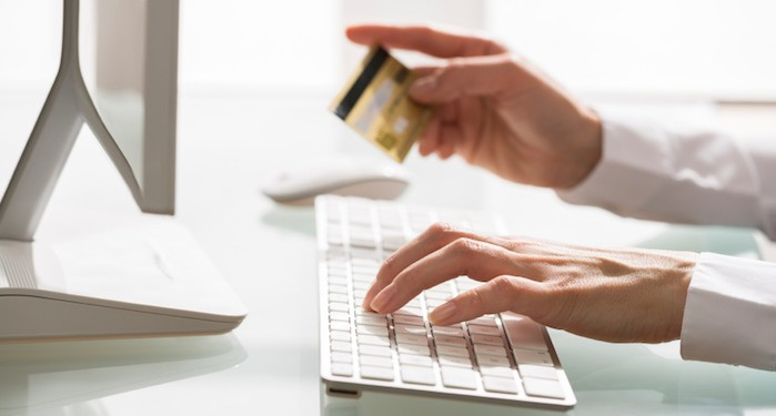 Woman shopping using computer and credit card