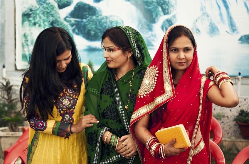 Happy Indian woman  gossip in party