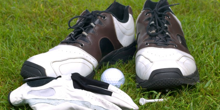 specialty golf shoes and accessories on the grass